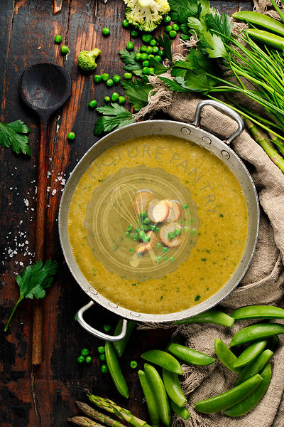 Vegetable cream soup on dark rustic background