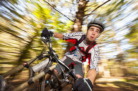 man riding mountain bike through corner