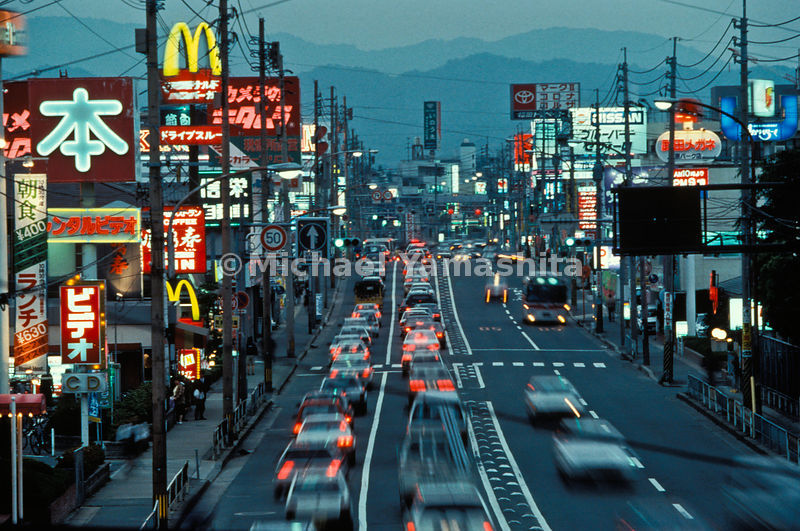 The aping of America can be found along almost any roadway. This garish street in suburban Fukuoka, a corridor that, for chaotic development, outdoes even the jumbled commercial strips of the U.S.