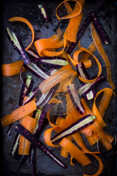 Purple and Orange Carrots, Shaved, on Dark Tray