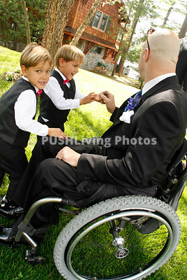 Man in a wheelchair at a wedding