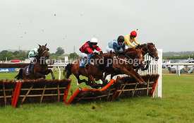 Barella winning the newtonabbotracing.com Selling Hurdle Race (Class 5) awkwardly jumping the final hurdle