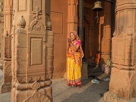 An old woman offers prayer, early in the morning in a temple at the ghats of Varanasi.