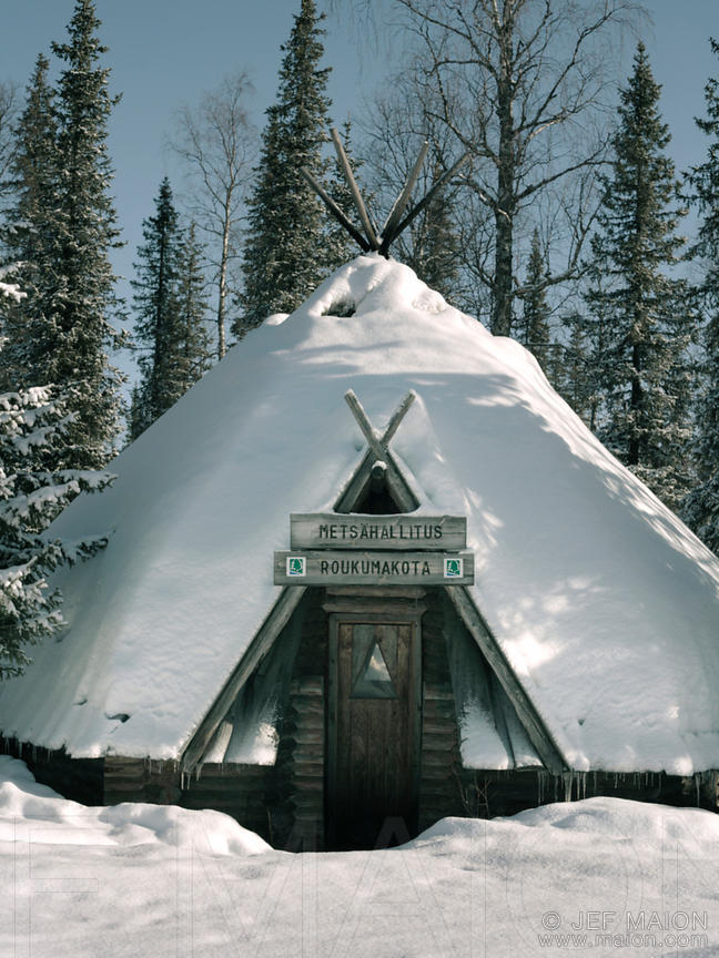 Wooden hut covered by snow
