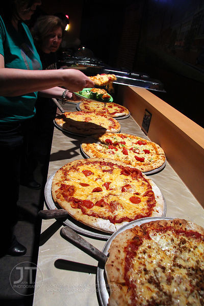 Pizza is laid out for a private party at Airliner Bar, 22 S Clinton Street in downtown Iowa City Saturday night. Copyright Justin Torner 2012 http://justintorner.photoshelter.com