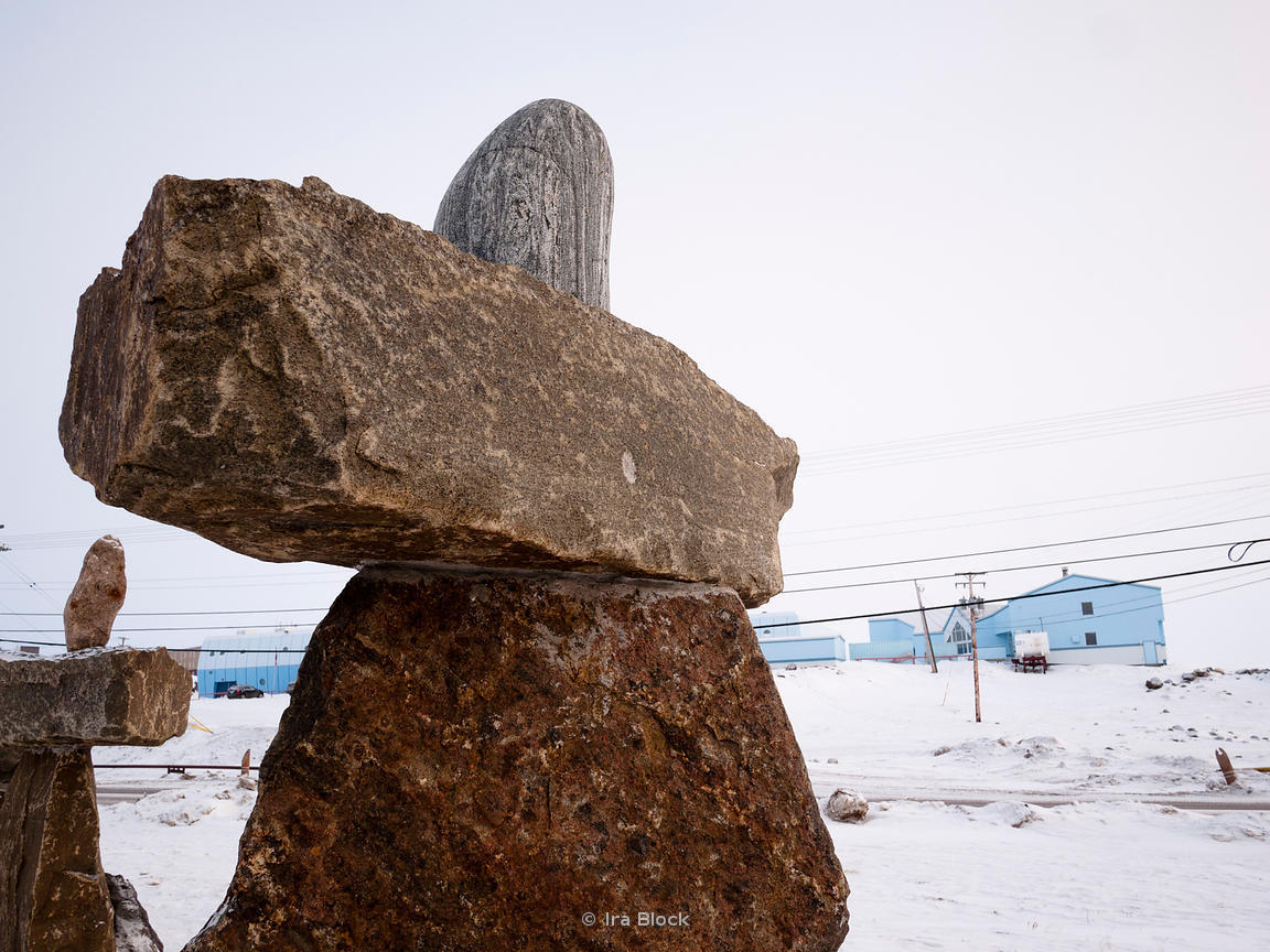 "Inuksuks, which are stone landmarks and Inuit cultural symbols in Iqaluit, Nunavut, Canada.  The word inuksuk means ""something which acts for or performs the function of a person"""