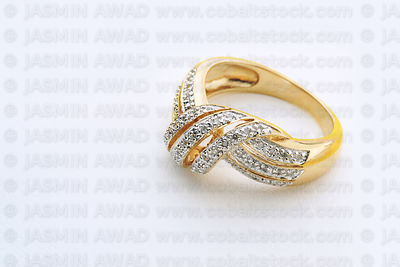 Gold wedding ring with many small diamonds