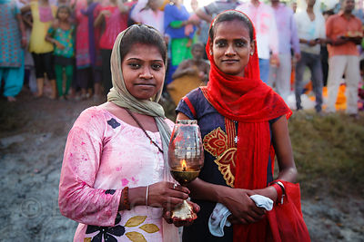 Sisters offer a prayer during immersion of Ganesh idols in the Yamuna River during the Ganesh Chaturthi festival, Delhi, India