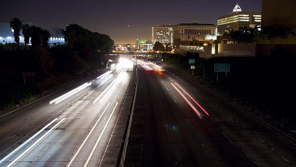 Medium Shot: Light Trails On A Shadowy Highway