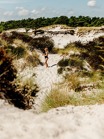 Girl at Dueodde beach on Bornholm, Denmark 2