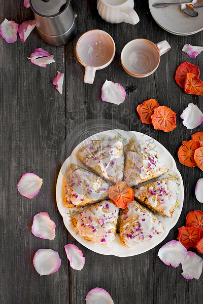 Persimmon Rose Scones served with espresso. Photographed from top view on a rustic gray wood background.