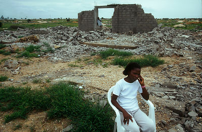 Angola - Luanda - Engracia Lourenco in the ruins of her home