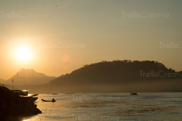 Scenic landscape view of Mekong river at sunset in Luang Prabang