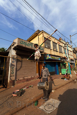 A man trains his five year old daughter to walk a tightrope in Taratala, Kolkata, India. She will perhaps work for tips in a carnival act.