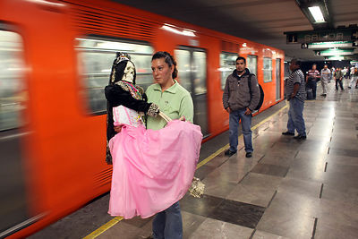 The faithful go by metro to the altar of the Santa Muerte in Tepito neighborhood for the Rosary That takes up on the first day of Each month.