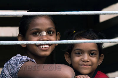 Girl and her brother on a train in Alipore, Kolkata, India.
