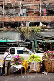 Independent flower vendors line the streets of the outdoor market in Bangkok, Thailand.