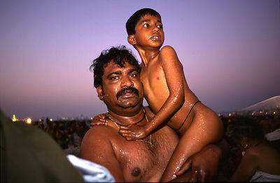 India - Allahabad - A pilgrim and his son after their ritual bath.Ardh Kumbh Mela 1995, Allahbad, India