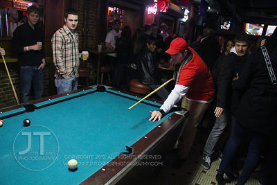 Patrons play pool at the Sports Column, 12 S. Dubuque Street, in downtown Iowa City Saturday night. Copyright Justin Torner 2012, http://justintorner.photoshelter.com