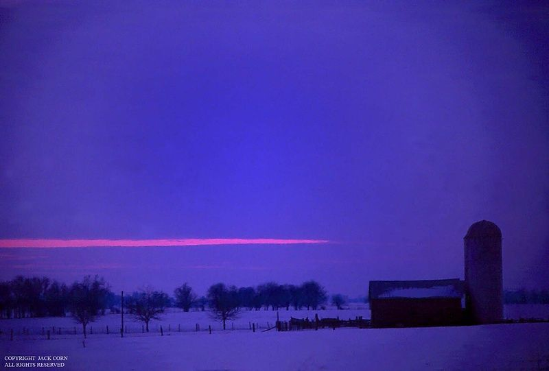 Twilight at snow covered farm