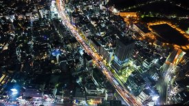 Bird's Eye: A Combination Of Side Streets & Freeways In Night Lights