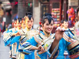 Parade of women in traditional chinese dress, Pingyao, China