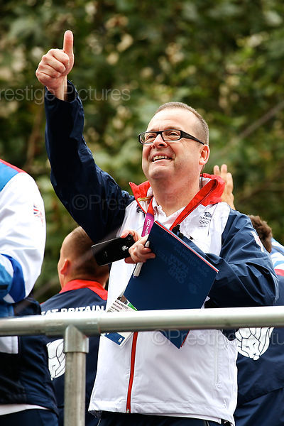 Press Attache Richard Prescott with the Athletes on their Victory Parade