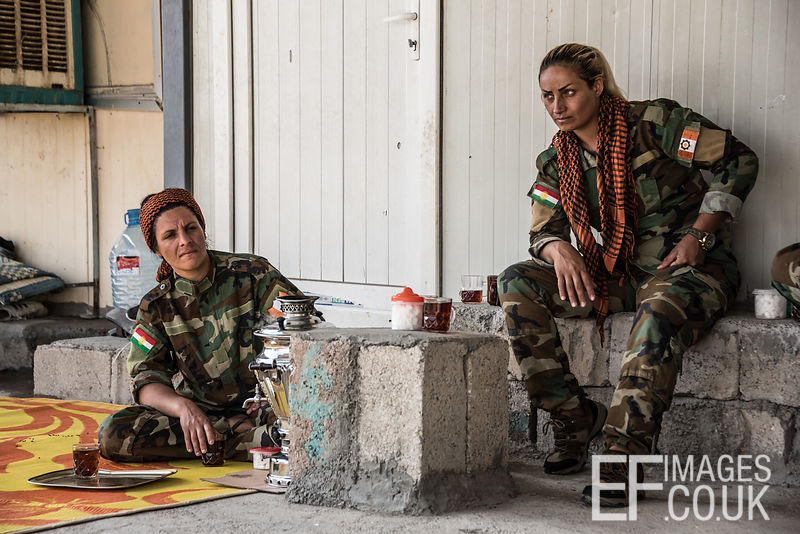 PAK (Kurdistan Freedom Party) female fighters taking a tea break at her base north of Hawija, where Kurdish Iranian fighters are holding the line against the last vestiges of Daesh and preparing to engage the Hashd al Shaabi forces threatening Kirkuk. Kirkuk Governorate, Iraq, 14th October 2017