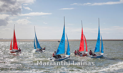 Red and blue dinghies at West Kirby