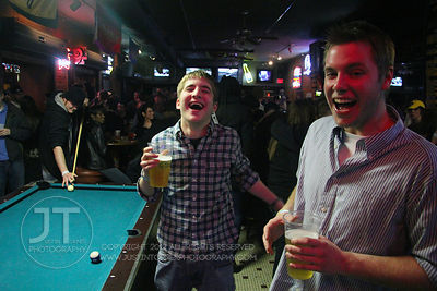 Patrons react to the camera at the Sports Column, 12 S. Dubuque Street, in downtown Iowa City Saturday night. Copyright Justin Torner 2012, http://justintorner.photoshelter.com