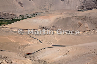 A lorry on the Arica to La Paz (Bolivia) road as it snakes uphill through ultra-arid desert, Upper Lluta Valley, northernmost Atacama Desert, Region XV Arica-Parinacota, Chile