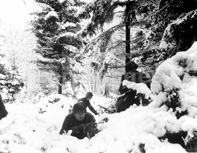 American soldiers fight in fresh snow during Battle of the Bulge