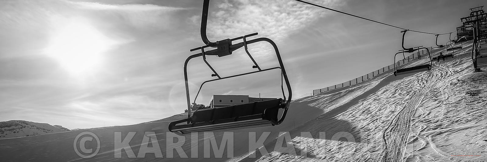 Panorama - Emty chairlift serie with sun and snow