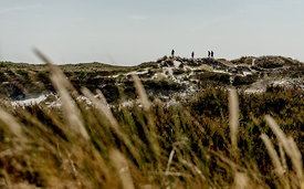 People on the dunes at Dueodde beach on Bornholm, Denmark