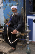man smoking a water pipe or Sheesha, Luxor, Egypt