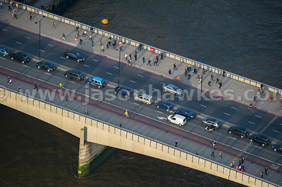 Aerial view of commuters crossing London Bridge, London