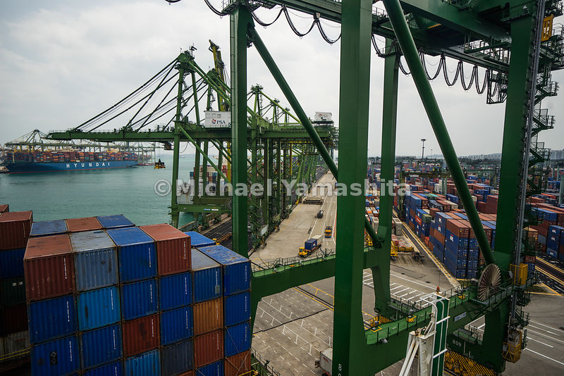 View of a a PSA terminal and containers, both on ships and at port.