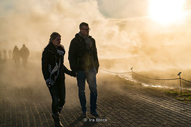 Tourists at the Geysir in southwestern Iceland.
