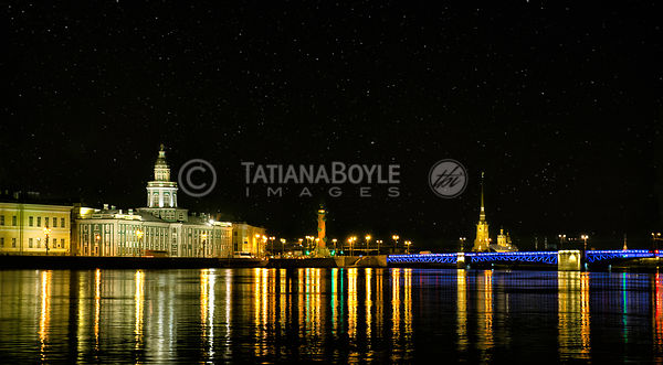 Evening view at Kunstkamera, Palace Bridge, and Peter & Paul Fortress; St. Petersburg, Russian Federation