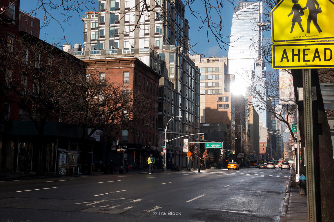 A street scene on a sunny day in Manhattan, New York.
