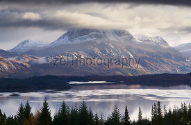 The summits of Slioch and Beinn a Mhuinidh over Loch Maree in the Scottish Highlands, Scotland, UK.