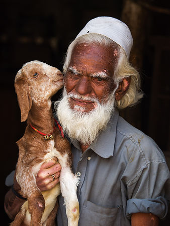This portrait of an old man with his lamb was shot in a shop in a village in Udaipur