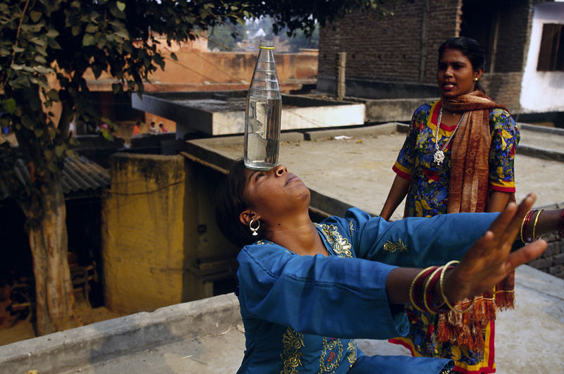 India - New Delhi - Reenu, 15, practices her contortions.