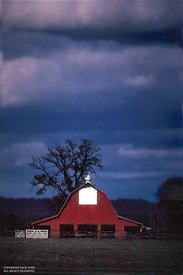 Red barn with dark sky