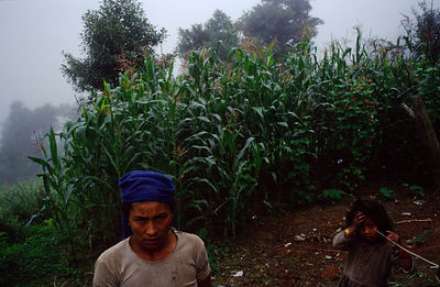 A peasant farmer woman and her child, in their fields, Dolakha region, Nepal