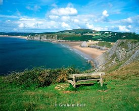 bench on pennard cliffs overlooking three cliffs bay gower peninsula glamorgan south wales