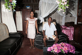 "Vanilla producer 43-year old Patrick Razafiarivo poses with his wife Lalao in their living room on May 26, 2016 in the municipality of Ambomalaza, Sambava, Madagascar. According to an interministerial decree, the collecting of the ""green vanilla"" (Raw vanilla) must begin on the 20th of June 2016. All collecting of vanilla before this date is considered as illegal. Many producers don't respect this decree and can sell illegaly this raw vanilla about 70 000 Ariary (20 USD) per kilogram. The buyers speculate on this vanilla and can resell it between 300 000 and 600 000 Ariary (93 and 186 USD) to big exporters. The sweet flavours of vanilla are taking on a bitter edge for buyers in Madagascar as prices have almost quadrupled but quality has declined, with experts blaming speculation, money laundering and a poor harvest. Madagascar, producer of 80 percent of the world's vanilla, has seen the spice's price jump from about $60 per kilogramme (2.2 pounds) in 2014 to as much as $220 now. In some local supermarkets, vanilla -- used in everything from ice cream to cakes -- has become so expensive that the pods have been removed from the spice aisle and placed close to the cash registers to deter thieves."