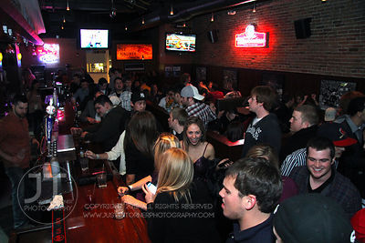 Bar patrons fill the Airliner Bar, 22 S Clinton Street in downtown Iowa City Saturday night. Copyright Justin Torner 2012 http://justintorner.photoshelter.com