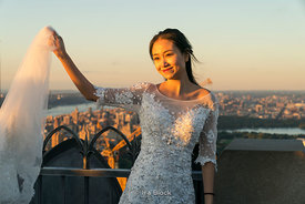 A woman poses for a picture on top of the Rockefeller Center in New York City.