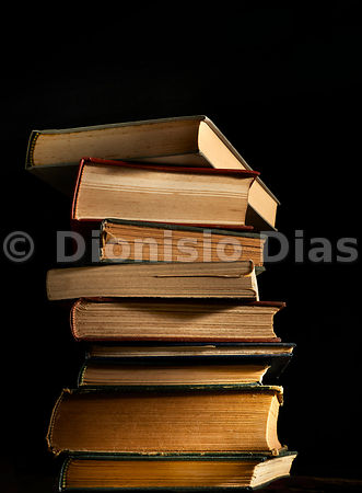 Stack of ancient books, in dark background